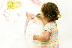 Young child girl painting over white Royalty Free Stock Image