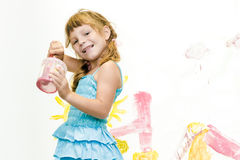 Young child girl painting over white Stock Photo