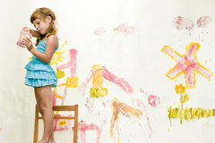 Young child girl painting over white Stock Images