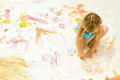 Young child girl painting over white Royalty Free Stock Photos