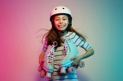Young child girl in safety helmet with roller skates - sports Royalty Free Stock Photos