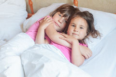Young child girl sleeping in bed at home, indoor Royalty Free Stock Photography