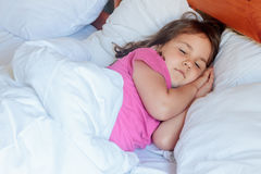 Young child girl sleeping in bed at home, Stock Images