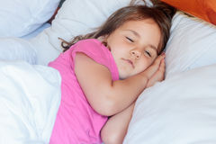 Young child girl sleeping in bed at home Stock Photos