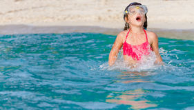 Young child girl snorkelling in mask on tropical beach backgroun Royalty Free Stock Photography