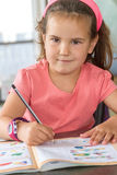 Young child girl writing in notebook Royalty Free Stock Photography