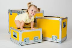 Young child girl between yellow road cases Stock Photo