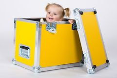 Young child girl between yellow road cases Royalty Free Stock Image