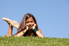 Young child on the grass royalty free stock image