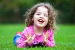 Young Child In The Grass Royalty Free Stock Photos