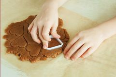 Young child hands is preparing the dough, bake cookies in the kitchen. Close up concept of family leasure royalty free stock photography