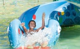 Young child having fun in aqua park. Boy having fun in aqua park Royalty Free Stock Photos