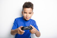 Young child having fun playing video games. A young child having fun playing video games Stock Images