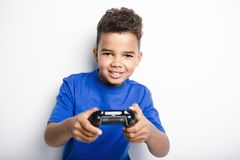 Young child having fun playing video games. A young child having fun playing video games Royalty Free Stock Photos