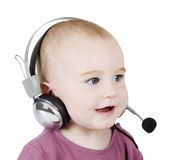 Young child with headset Royalty Free Stock Images