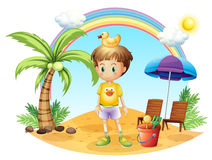 A young child with his toys near the coconut tree Stock Images