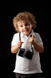 Young child holding a camera Royalty Free Stock Photo