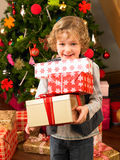 Young child holding gifts Royalty Free Stock Image