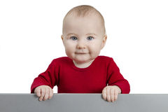 Young child holding grey sign Stock Photo