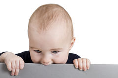 Young child holding horizontal sign Royalty Free Stock Photos