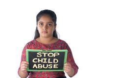 Indian girl showing a slate with `stop child abuse` text isolated over white background