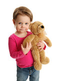 Young child holding a teddy bear Royalty Free Stock Photo