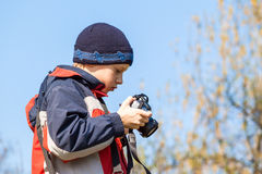 Young child holding and viewing photos on the camera Stock Photography
