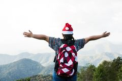 Young child holiday freedom. Young child with backpack and holiday hat in view point mountain background Stock Image