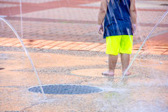 Free Young Child In City Splash Pad Royalty Free Stock Image - 96496816