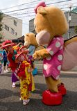 Young Child Japanese Festival Dancers and a Mascot Stock Photos