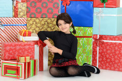 Young child leaning on christmas presents royalty free stock images
