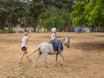 Young child learning to ride in the Upper Hunter Valley, NSW, Australia stock photo