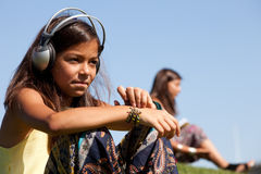 Young child listening music Stock Photography