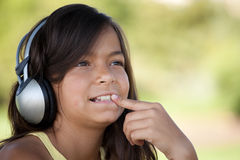 Young child listening music Stock Images