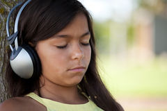 Young child listening music Royalty Free Stock Photo