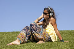 Young child listening music Stock Photos