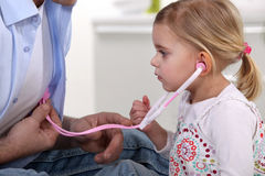 Young child listening to  heartbeat Stock Images