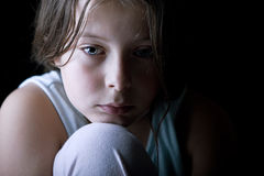 Young Child Looking Sad Stock Photo
