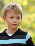 Young child in nature. Youn blond child in nature Royalty Free Stock Photo
