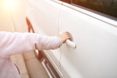 Young child open the car door Royalty Free Stock Image