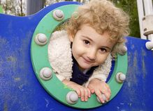Young child outdoors having fun at the playground. Stock Image