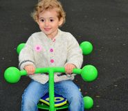 Young child outdoors having fun on a see-saw. Stock Photos