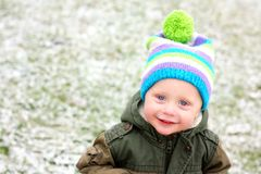 Young Child Outside in Fresh Winter Snow Royalty Free Stock Image