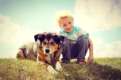 Young Child Outside with His Dog, Vintage Style Royalty Free Stock Photo
