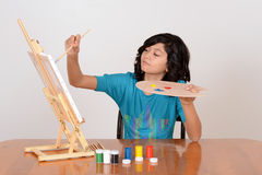 Young child painting Stock Images