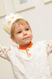 Young child with paper crown. Young child wearing a paper crown Royalty Free Stock Image