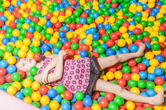 Young child playing in ball pool Stock Images