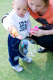 Young Child playing Bubbles Royalty Free Stock Photography