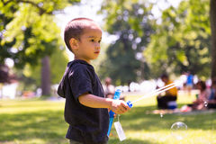 Young Child Playing with Bubbles Royalty Free Stock Image