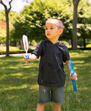 Young Child Playing with Bubbles Royalty Free Stock Photos